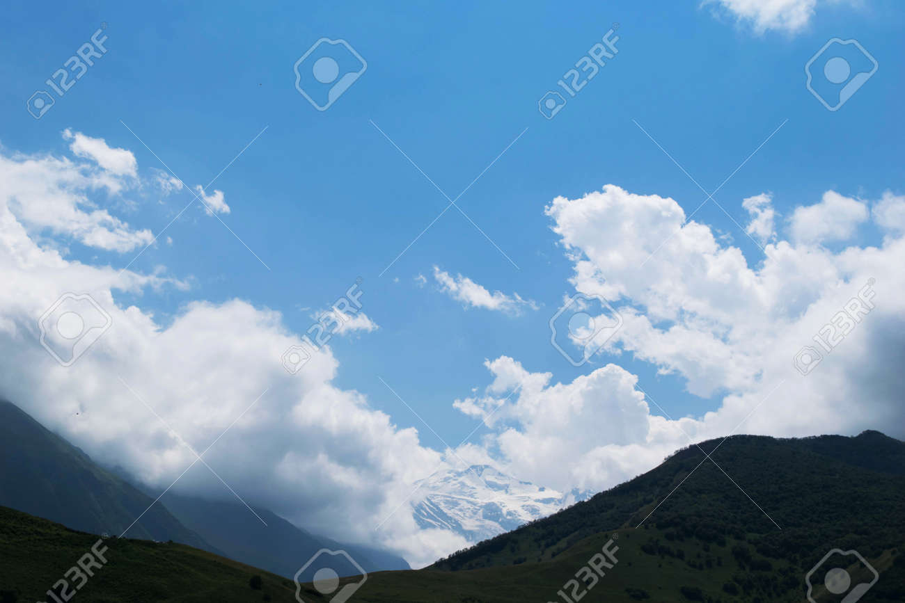 View of the mountains of the North Caucasus. Mountains in the clouds in summer - 157728827