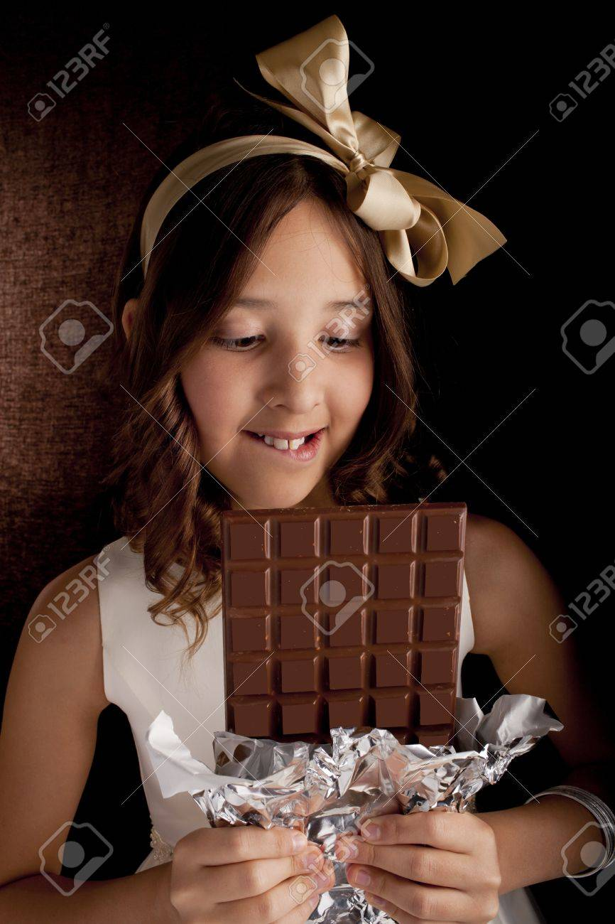 Girl With The Big Chocolate And With Bow On A Head Looking.. Stock ...