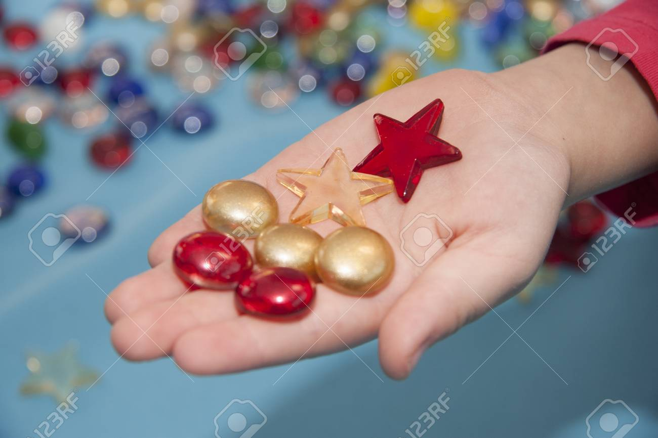 colored glass stones for child education and for design on the hand Stock Photo - 12445666