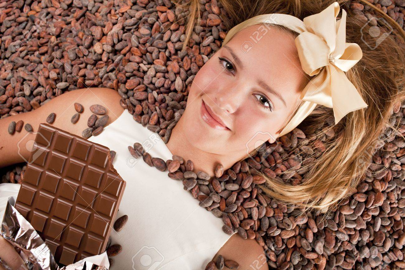 beautiful caucasian girl with chocolate is on a cocoa beans Stock Photo - 13138019