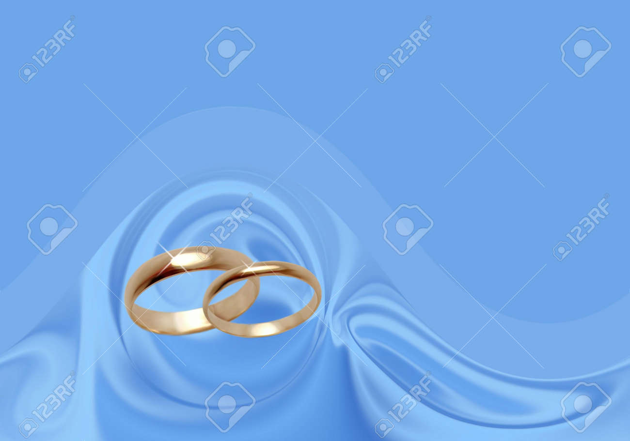 Wedding Rings On Blue Material. Background For The Invitation ...