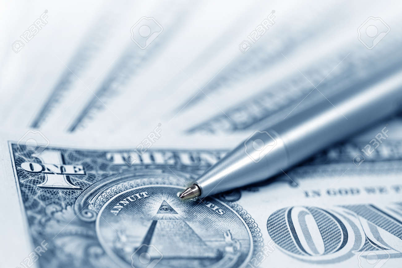 The American money dollars. Bundle of bank notes  and pen Stock Photo - 7101652