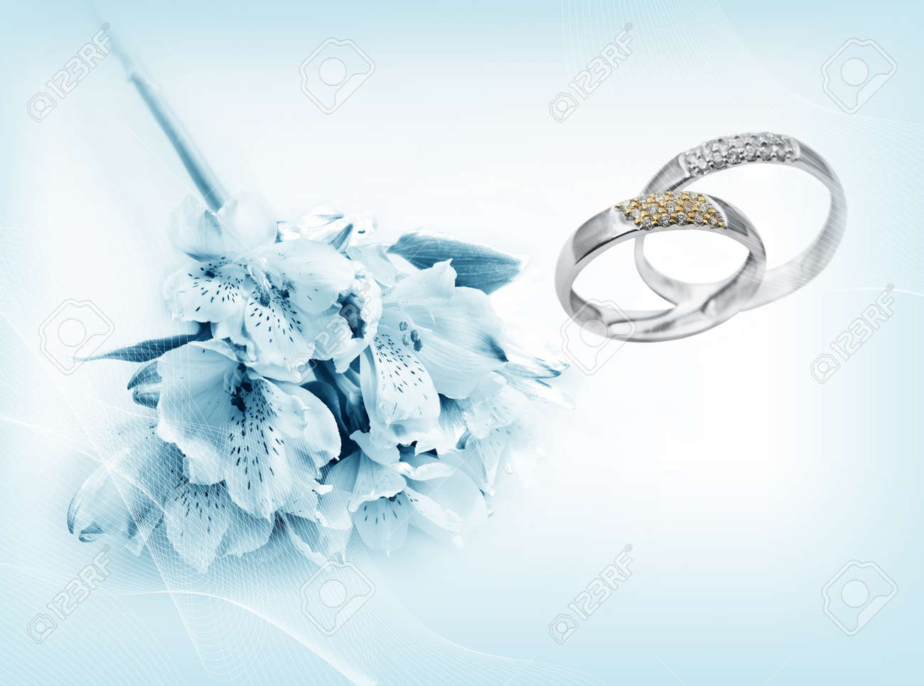 Wedding rings on blue background