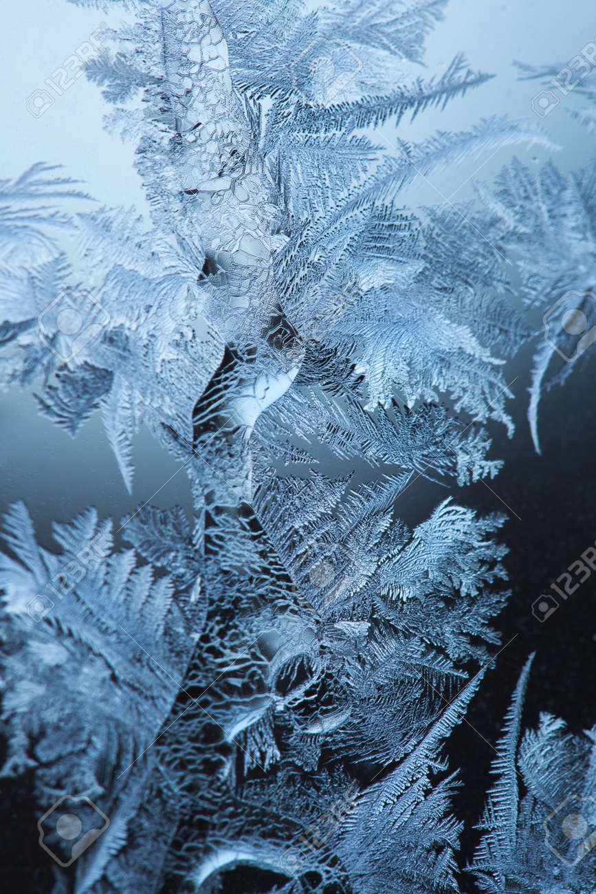 Frosty original  pattern at a winter window glass, natural texture Stock Photo - 9736806