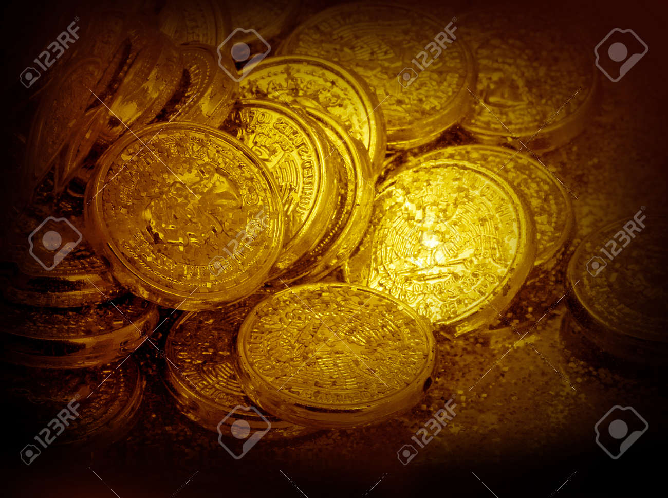 Golden coins in the dark brown frame Stock Photo - 13208204