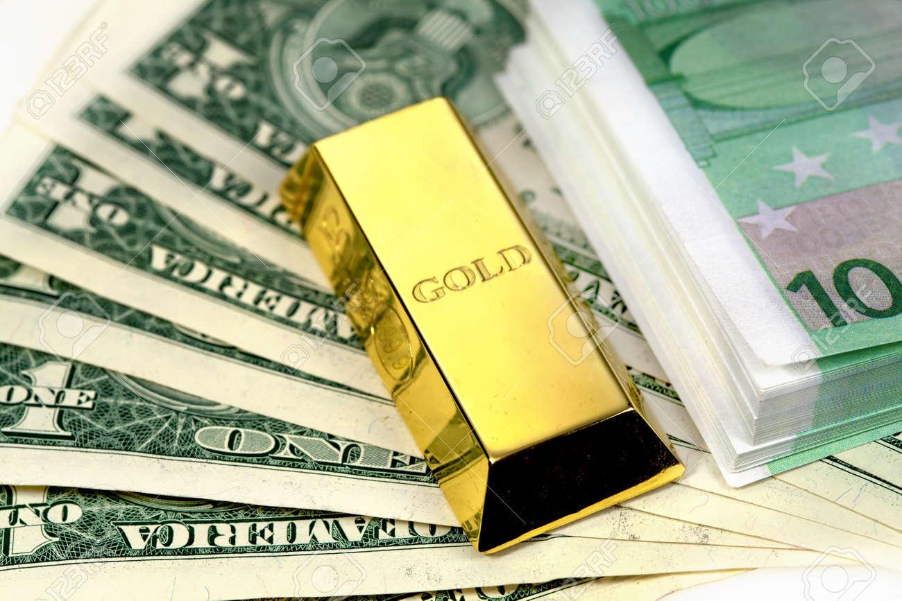 The money american dollars and gold bullion Stock Photo - 13471779