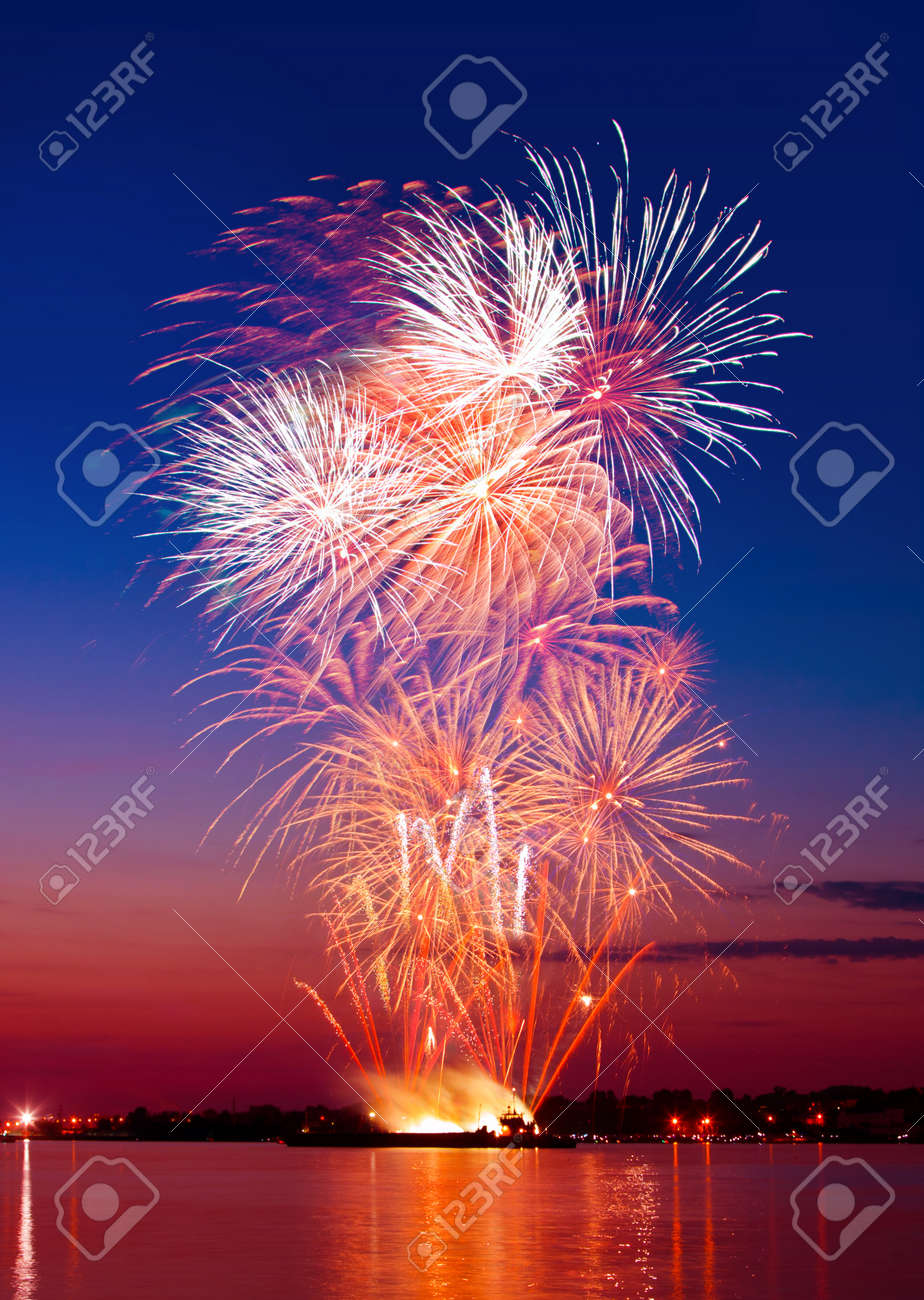 Colorful firework in a night sky, reflection in water Stock Photo - 13813062