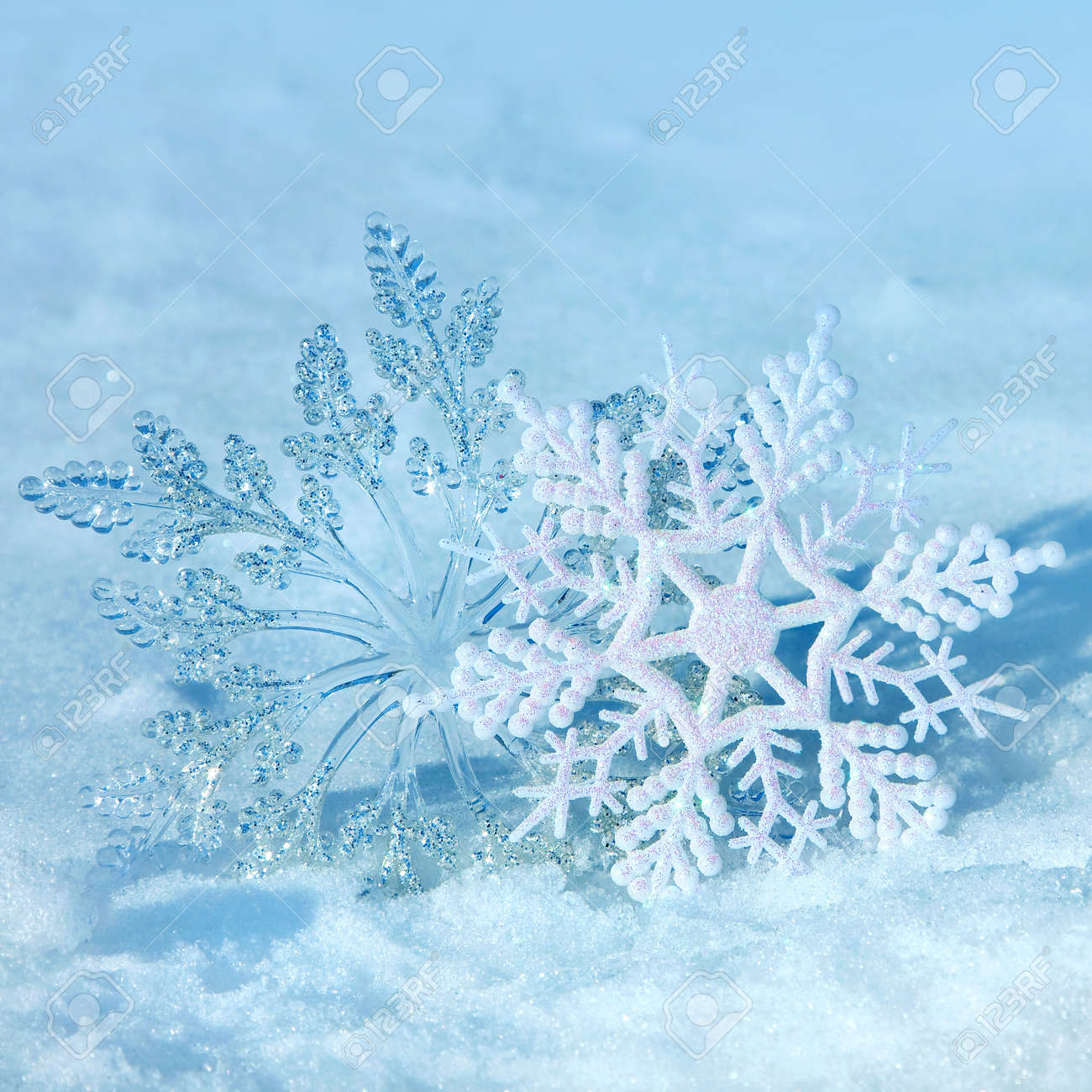Christmas Decorations Snowflakes On A Snow Background Of Nature ...