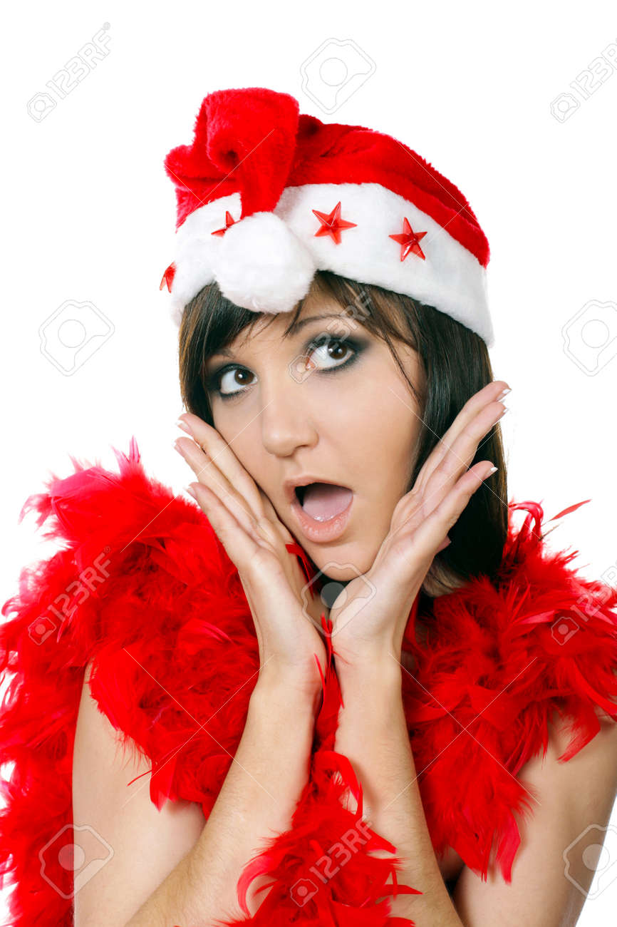 Young woman with open-mouthed of surprise in santa cap. Fashion studio portrait Stock Photo - 16014415