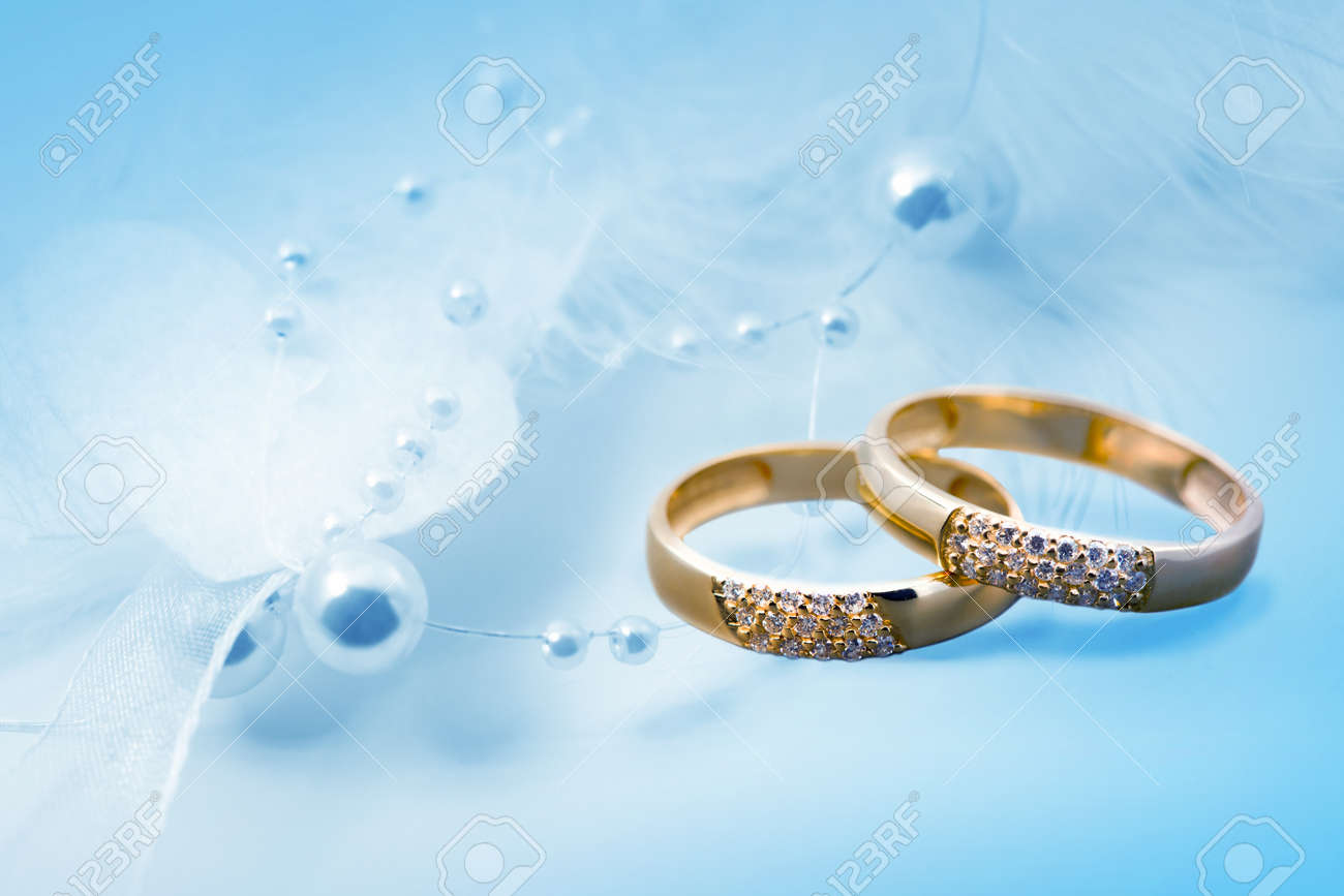 Wedding Rings On Blue Background For Card Stock Photo Picture And