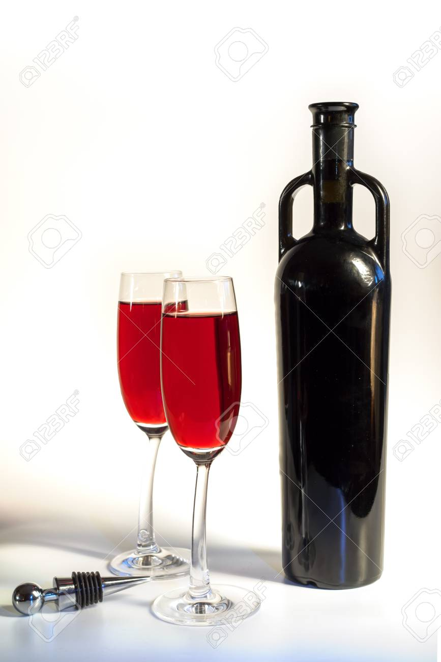 Original Red Wine Bottle And Two Wine Glasses On The White