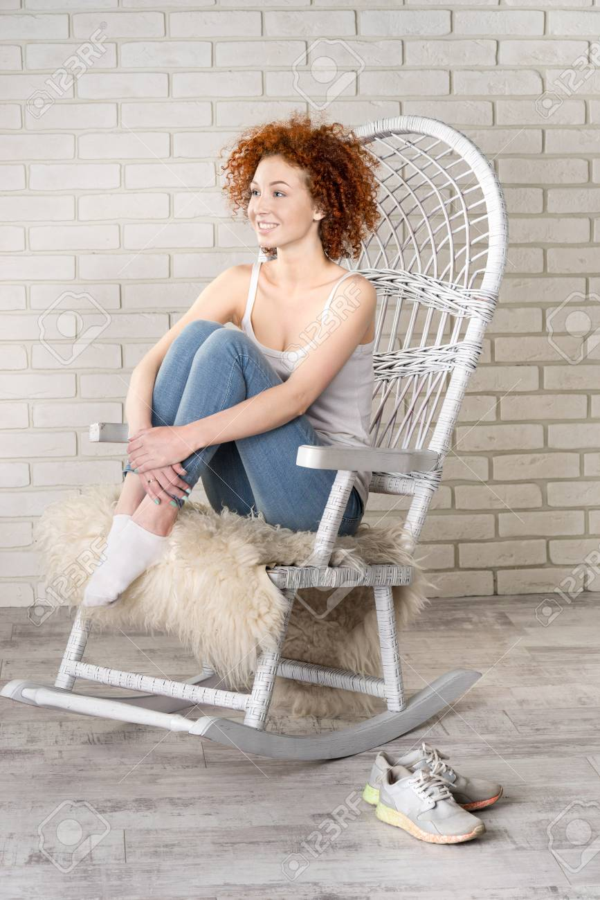 Tremendous Portrait Of The Young Beautiful Girl Sitting In A Rocking Chair Pdpeps Interior Chair Design Pdpepsorg