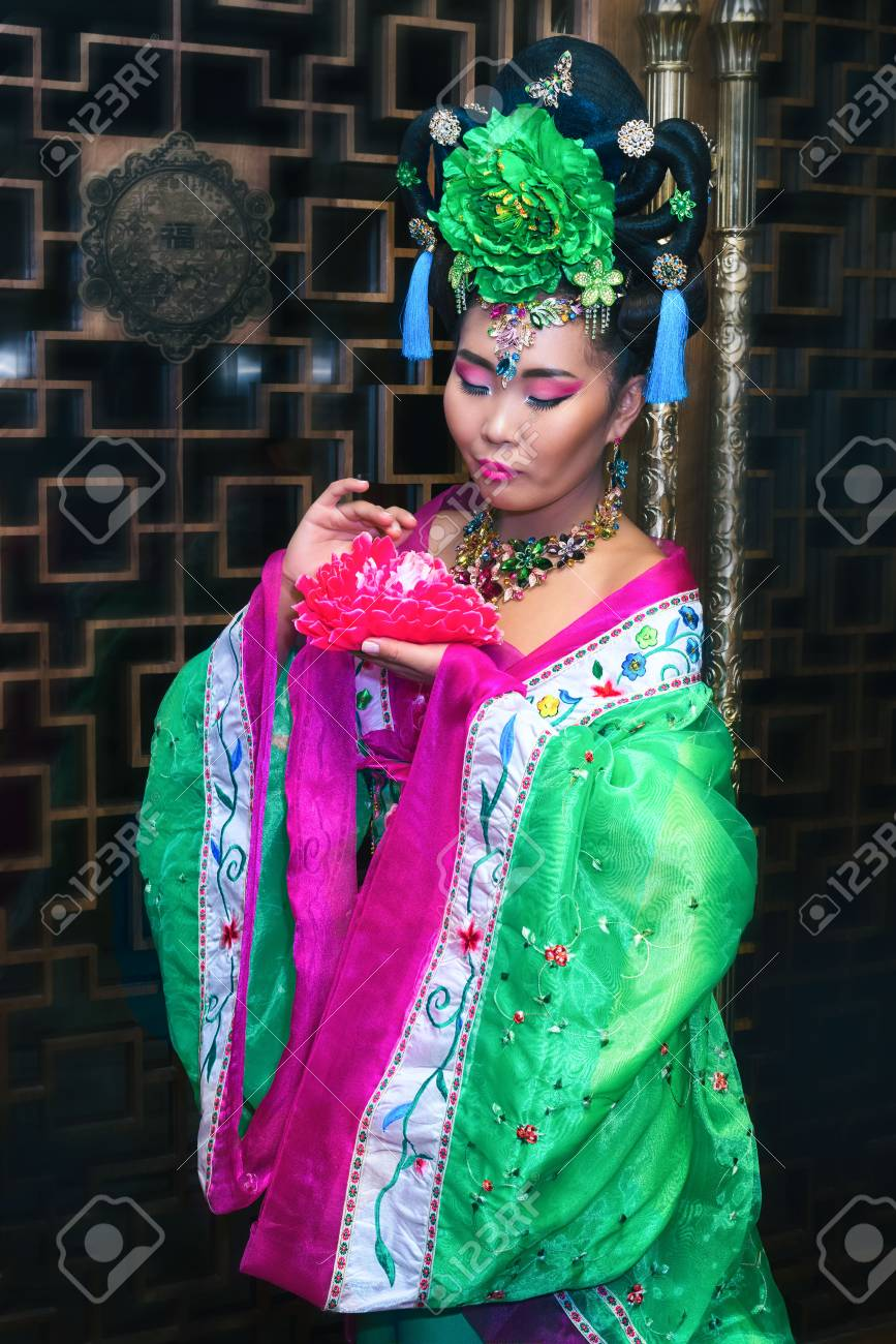 attractive young chinese woman in traditional chinese clothes