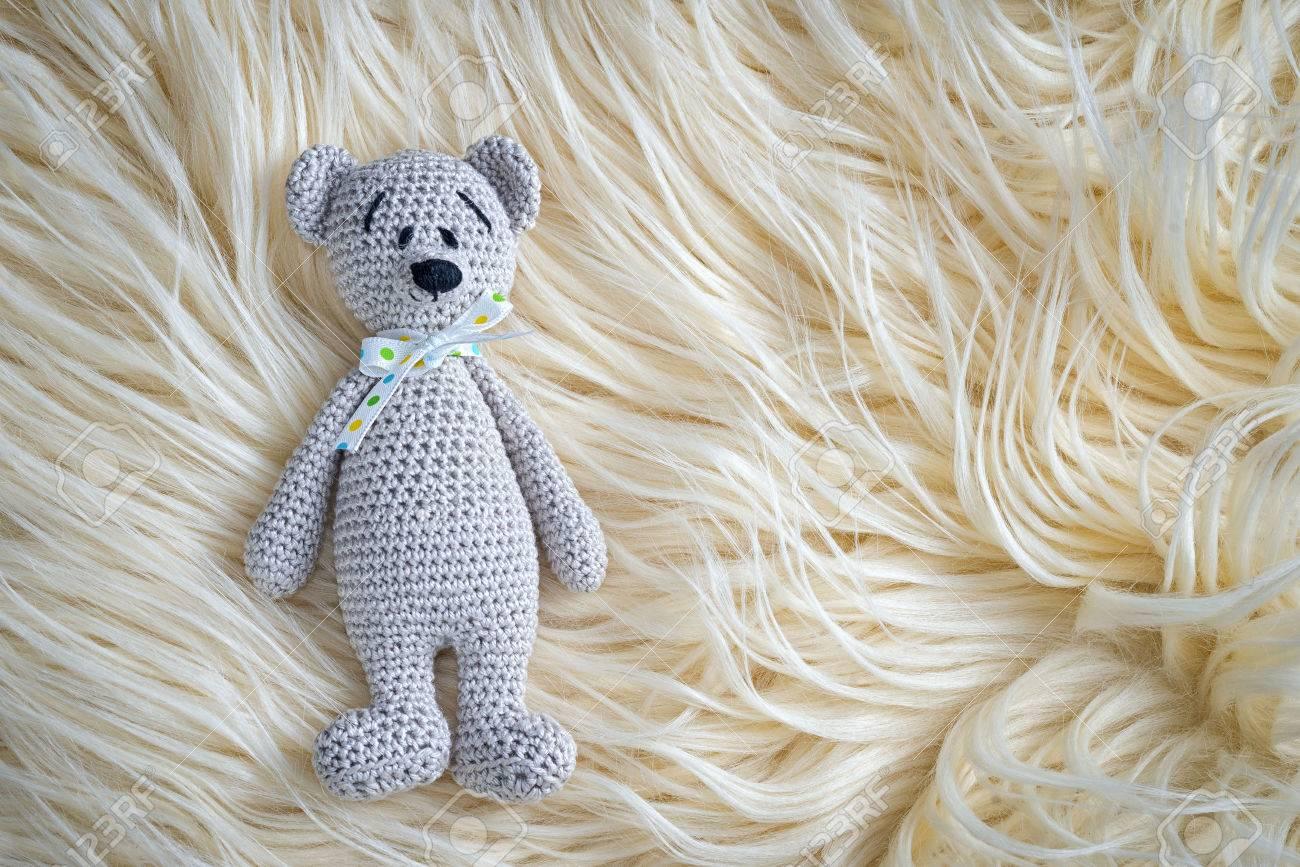Amigurumi Teddy Bears : Cute handmade crochet amigurumi teddy bear doll laying on the