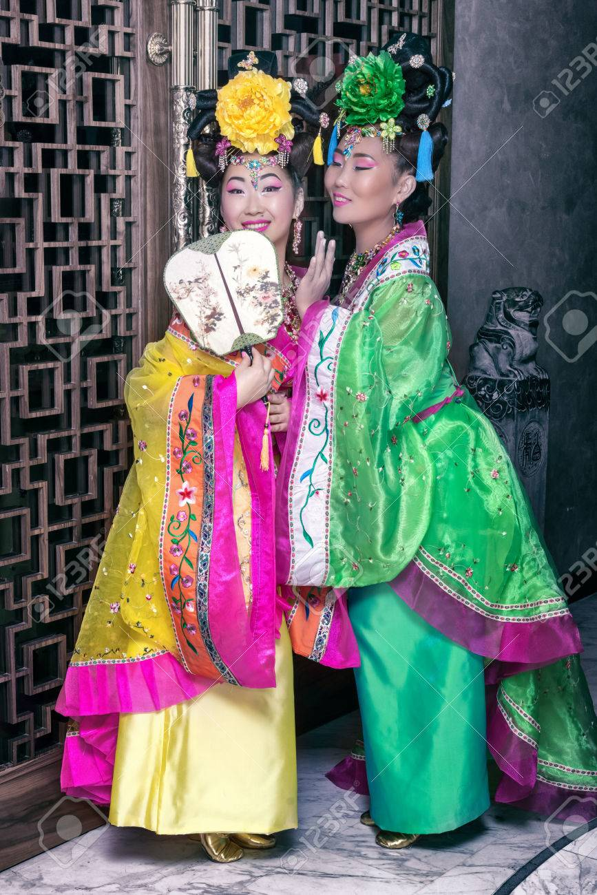 40158bf029a Stock Photo - two geishas whispering in traditional Chinese national dresses