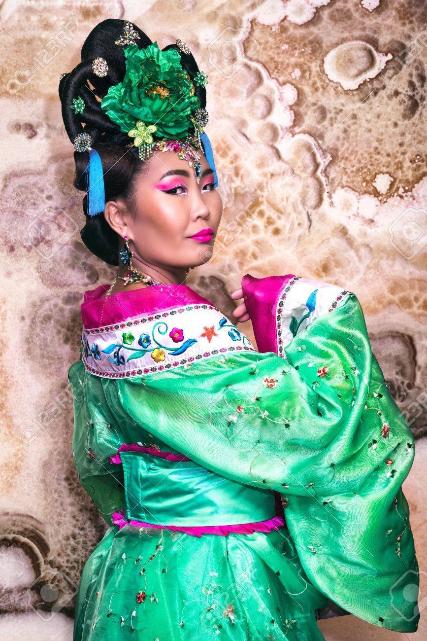 9a70a8137 portrait of chinese geisha in a very beautiful chinese traditional dress  with wide sleeves and flower