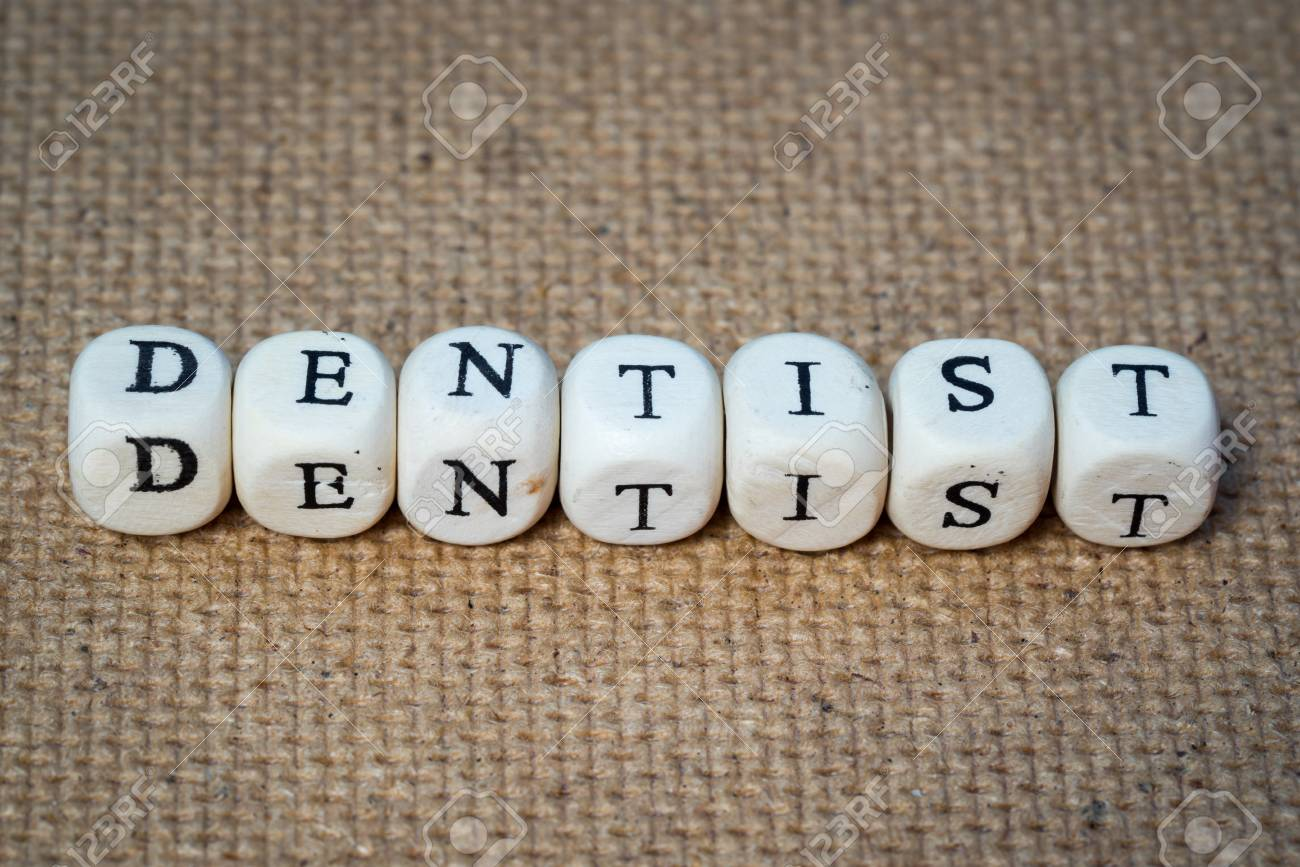 dentist word made from toy cubes with letters stock photo picture