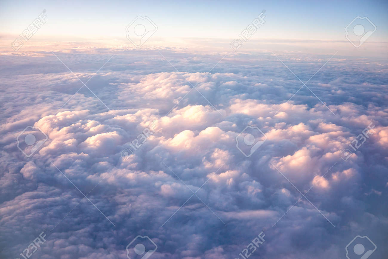 view sky and clouds from an airplane. flying above the clouds. - 122110039