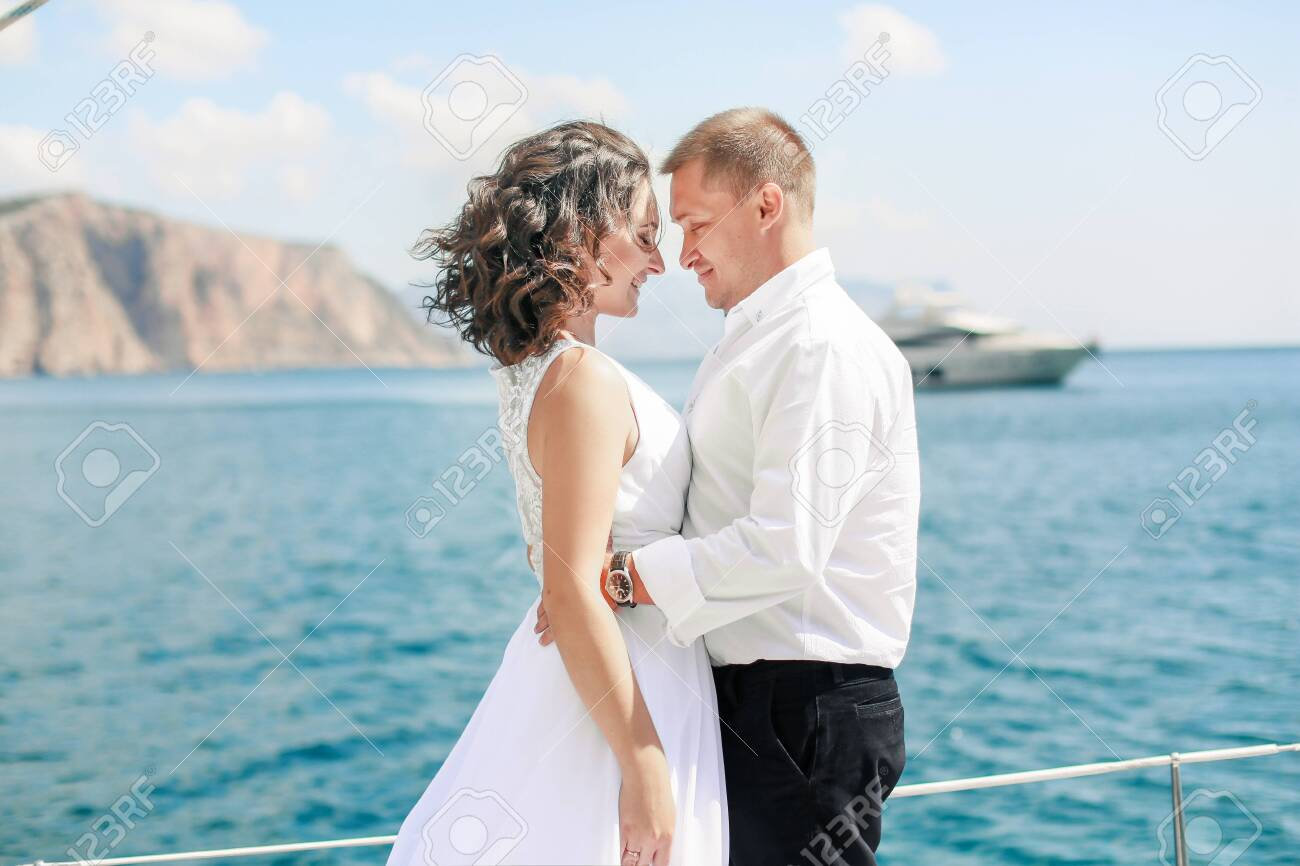 A Just married couple on yacht. Happy bride and groom on their wedding day. - 121738302