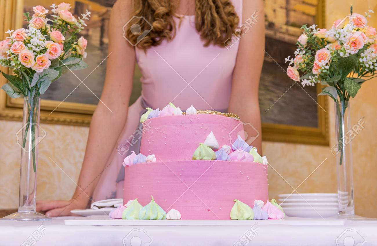 Girl in pink dress with birthday cake covered with pink glaze girl in pink dress with birthday cake covered with pink glaze 2 bouquets of flowers izmirmasajfo