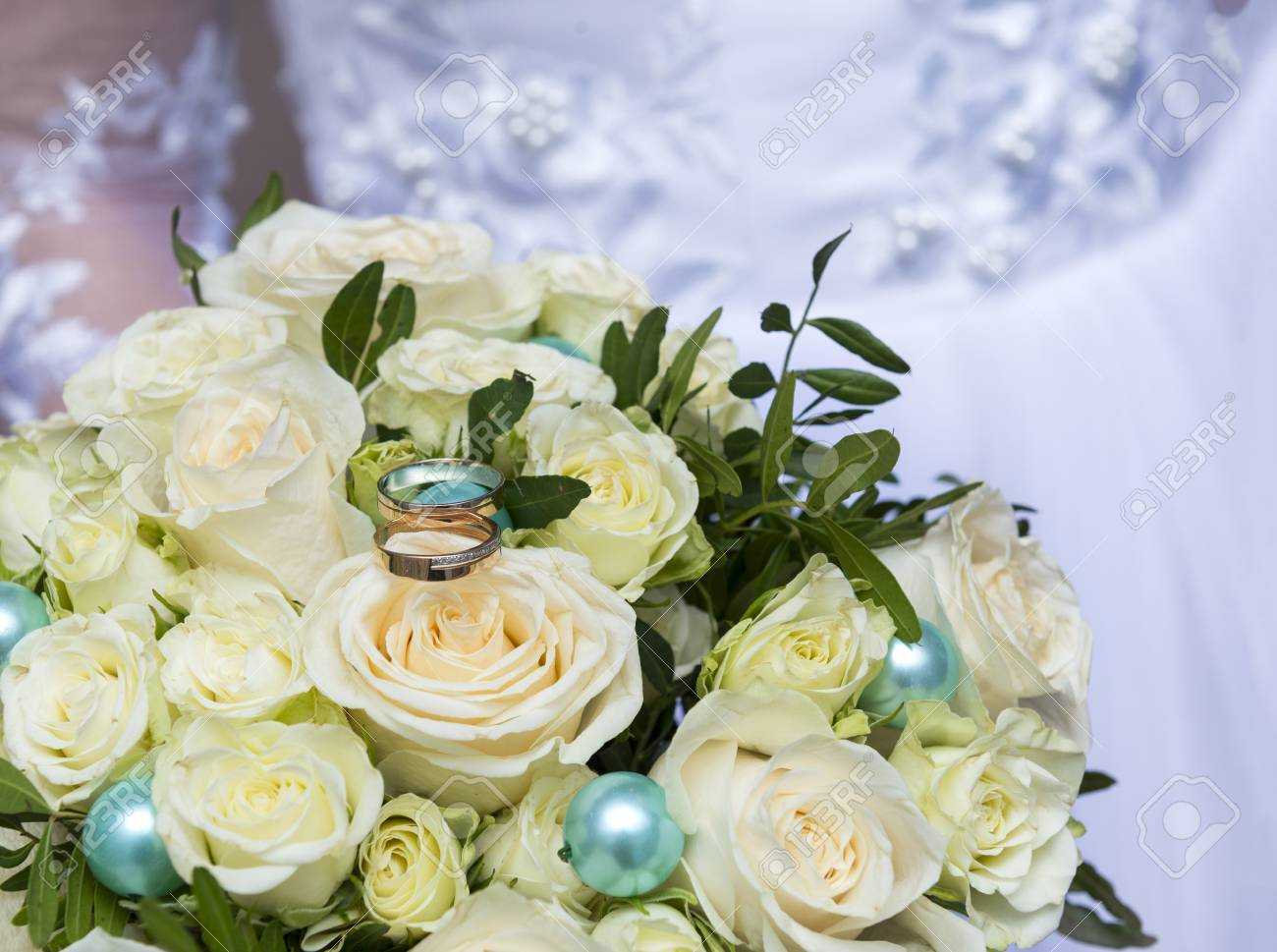 Wedding Bouquet Of The Bride From White Roses With Gold Wedding