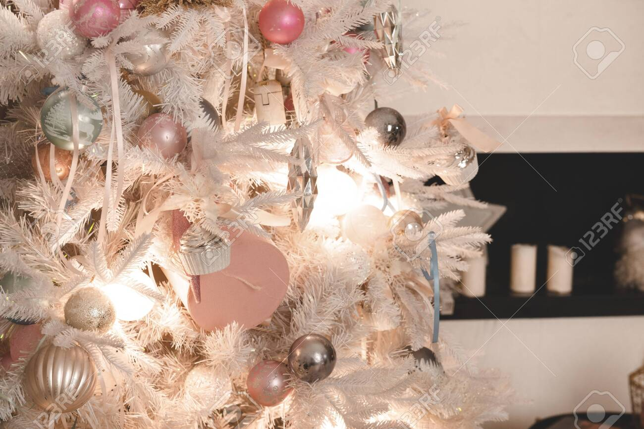 White Christmas Tree With Pink And Silver Balls And Lights Close Stock Photo Picture And Royalty Free Image Image 133774448