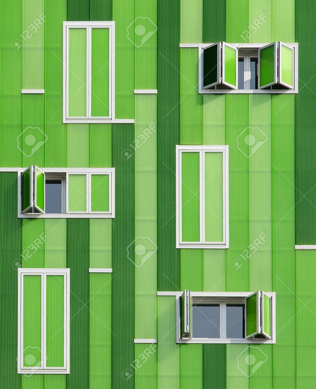 Modern building  Its green facade imitate the texture of bamboo with a lot of parallel vertical lines the windows have different sizes Stock Photo - 13769723
