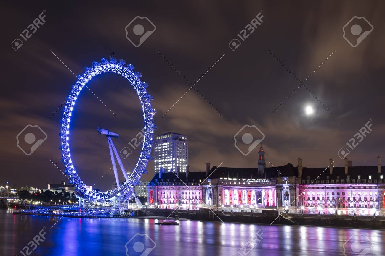 LONDON - SEPTEMBER 16: London Eye over Thames River at night, on SEPTEMBER 16, 2012 in London, United Kingdom. The entire structure of the London Eye is 135 meters tall and the wheel has a diameter of 120 metres. Stock Photo - 17877110
