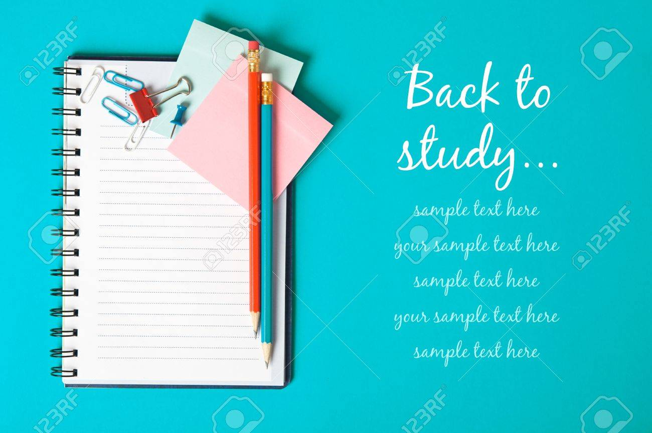 Notebook on the blue with copy space - 14657339