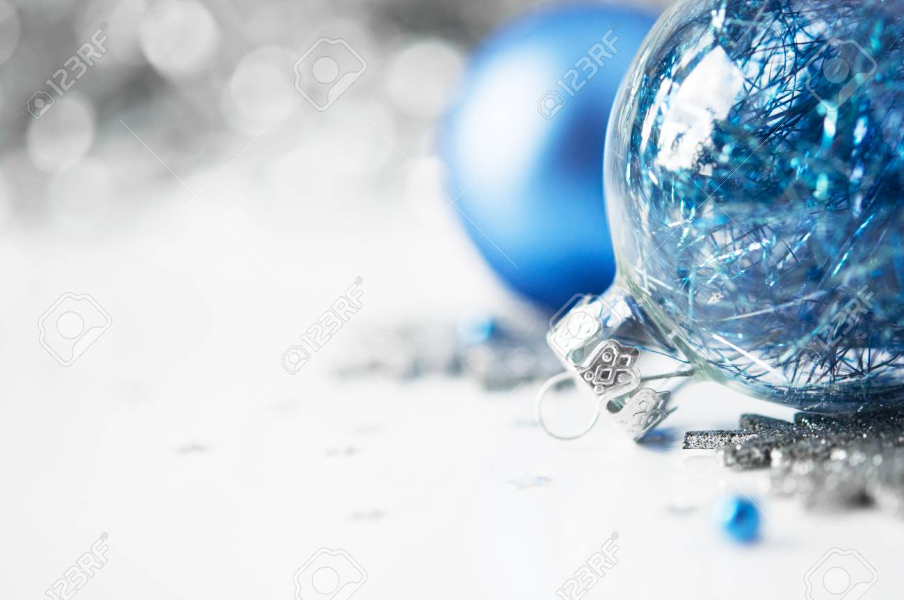 Blue and silver xmas ornaments on bright holiday background with space for text - 22931628