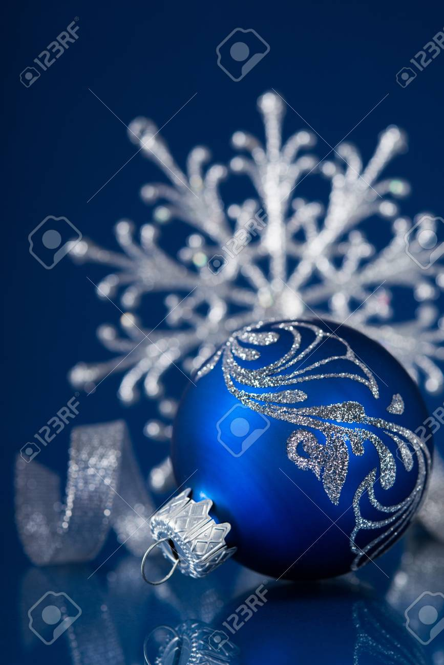 blue and silver christmas ornaments on dark blue xmas background with space for text stock photo - Navy Blue Christmas Ornaments