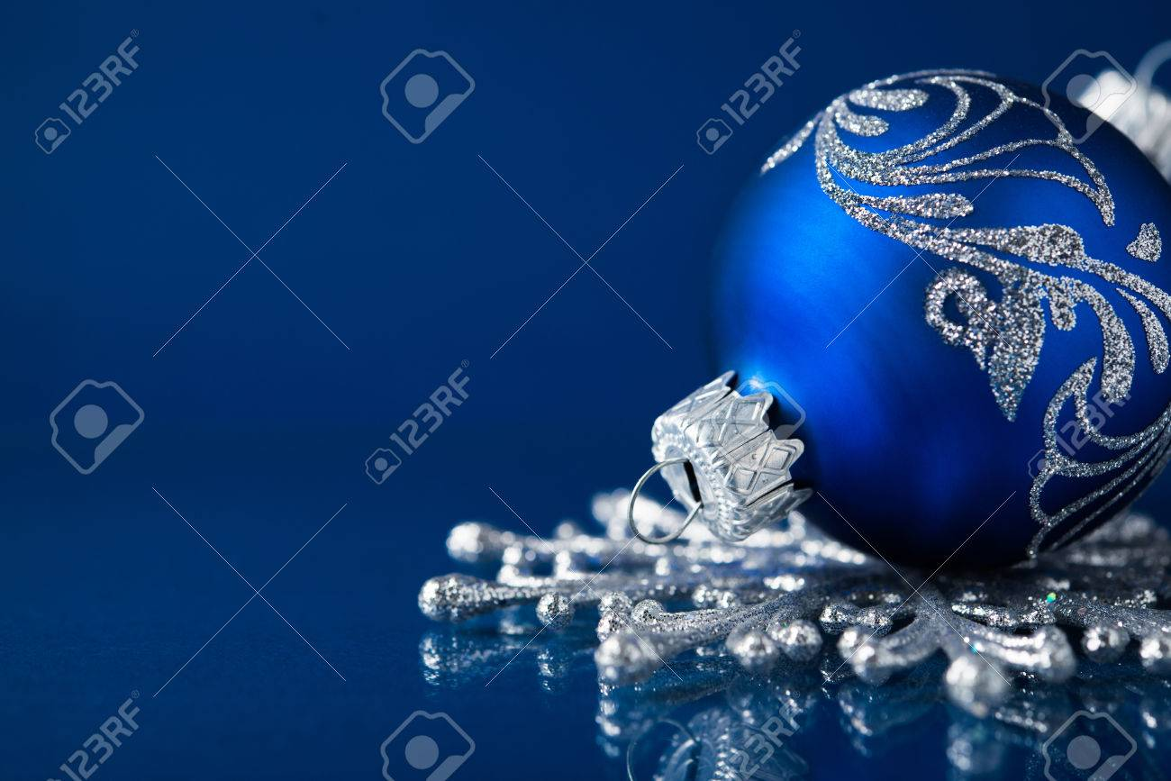 Christmas Ornament Background.Blue And Silver Christmas Ornaments On Dark Blue Xmas Background