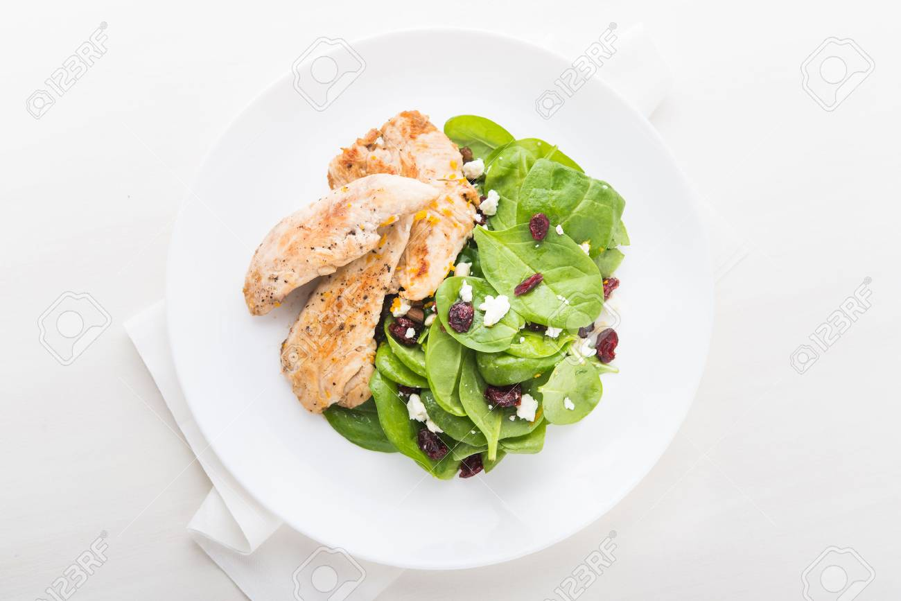 Chicken with spinach salad on white wooden background top view. Healthy food. - 53192650
