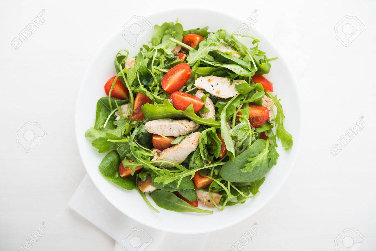 Fresh salad with chicken, tomato and greens (spinach, arugula) top view. Healthy food. - 53193792