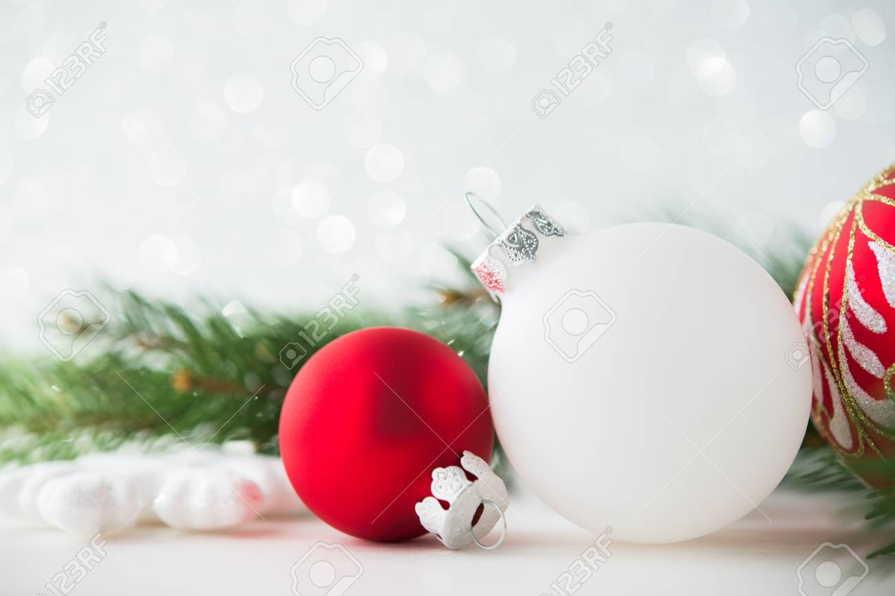 Red And White Xmas Ornaments On Glitter Holiday Background Merry Christmas Card Winter Theme