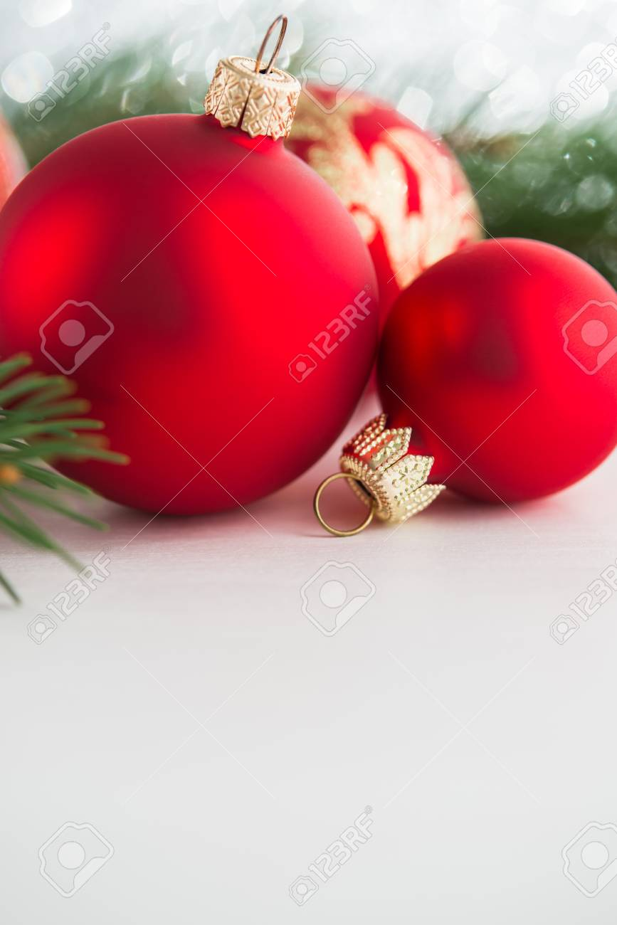 Red xmas ornaments on wooden background. Merry christmas card. Winter holiday theme. Happy New Year. Space for text. - 62705101