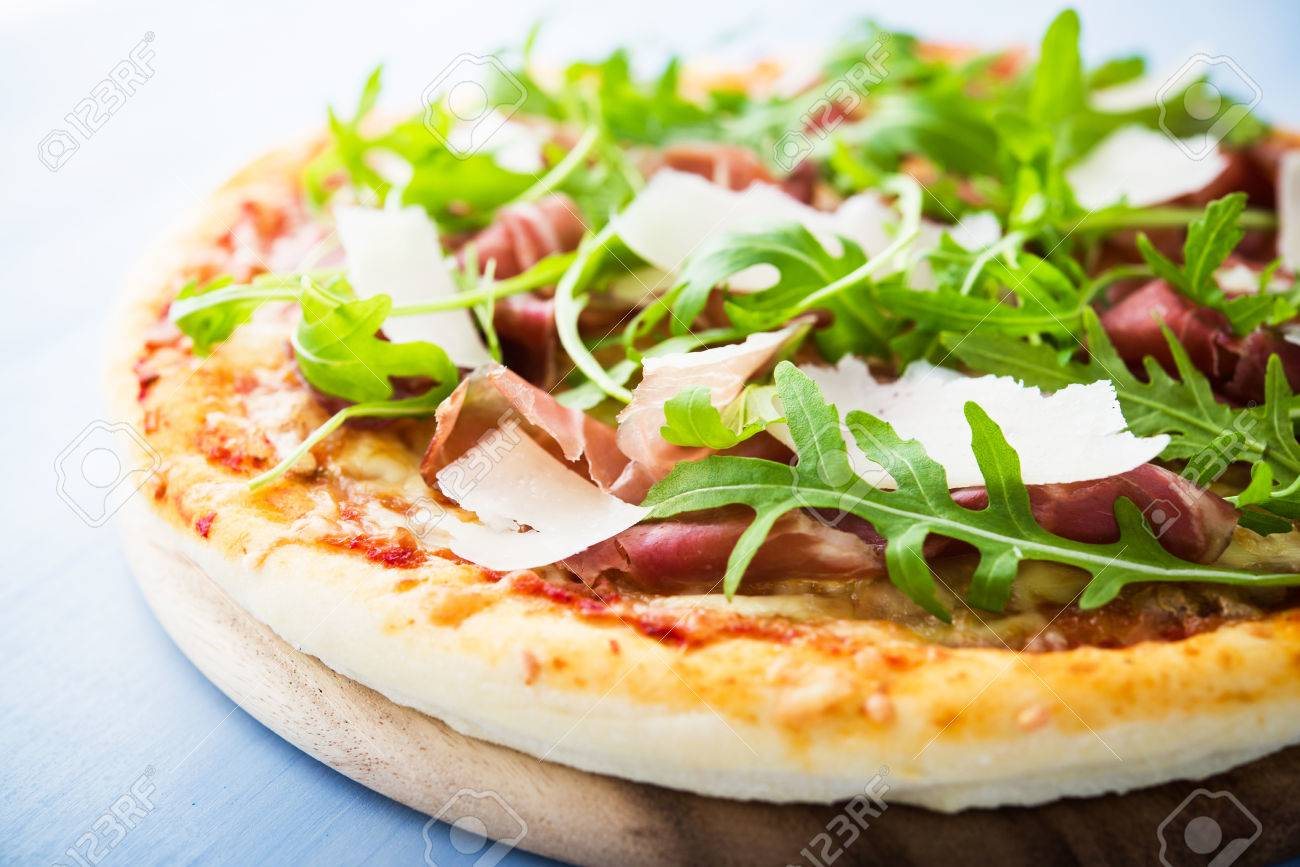 Pizza With Prosciutto (parma Ham), Arugula (salad Rocket) And.. Stock Photo, Picture And Royalty Free Image. Image 62705779.