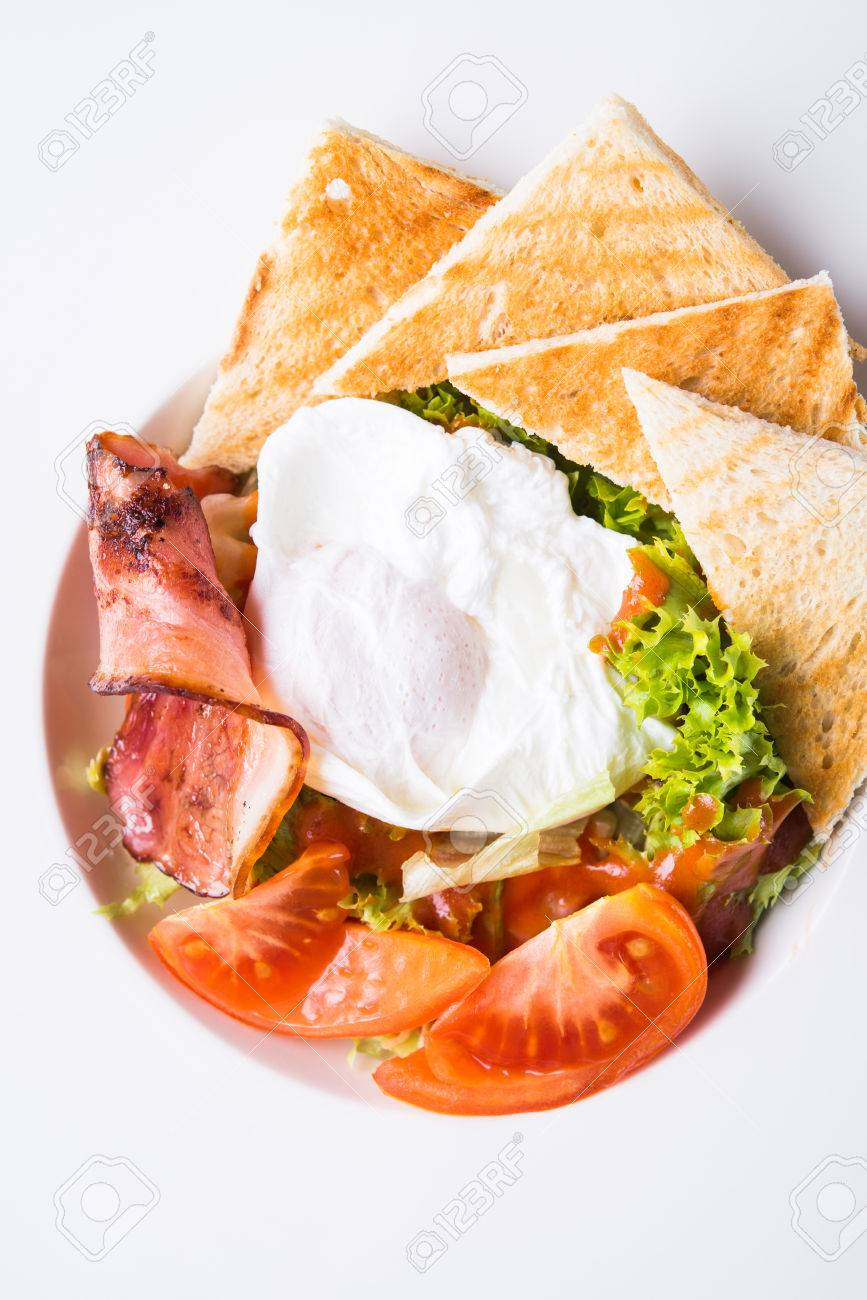Fresh salad with egg, tomato, bacon and lettuce on wooden background close up. Healthy food. - 65894054