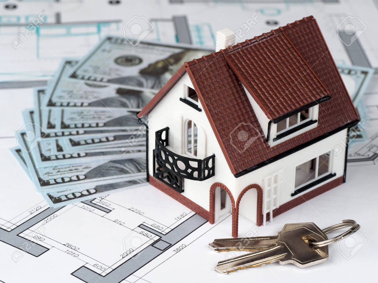 Toy House And Keys On Building Plan With Money On Background Stock Photo Picture And Royalty Free Image Image 84158481