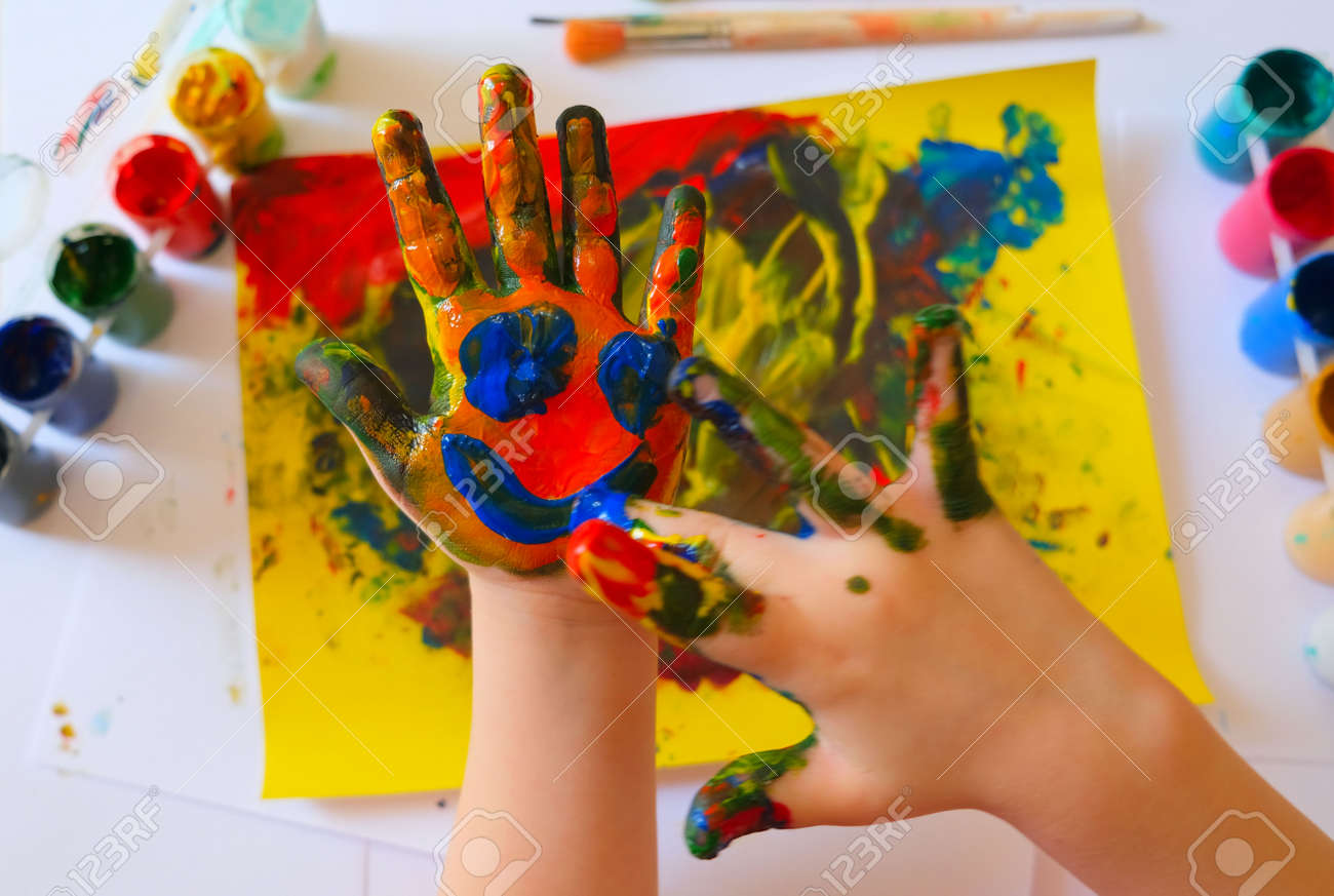 Child painting by finger hand. Ideas for drawing with finger paints. Children development. The concept of a happy childhood and children's day. - 169038668