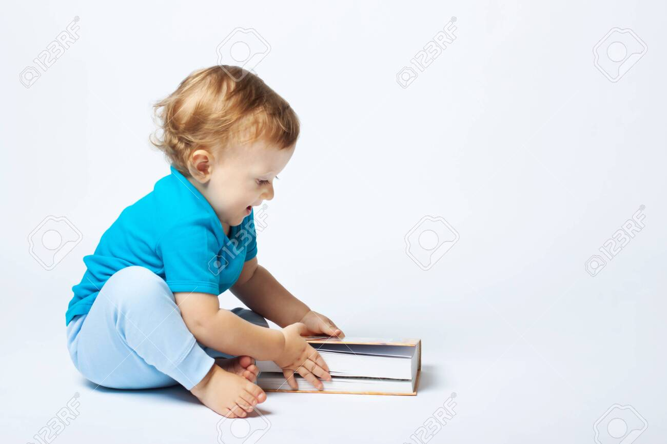 Cute Baby Boy Playing With Book On The White Background Copy