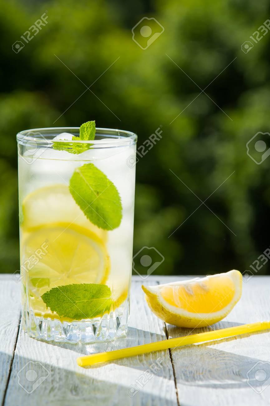 Citrus fresh lemonade in garden setting,summer drink. - 102746782