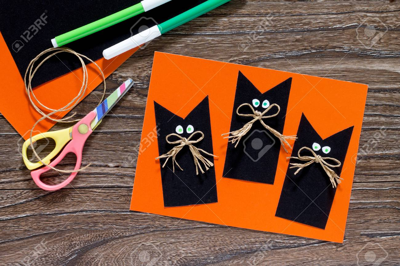 The Child Create A Greeting Card Halloween Black Cat Out Of Paper