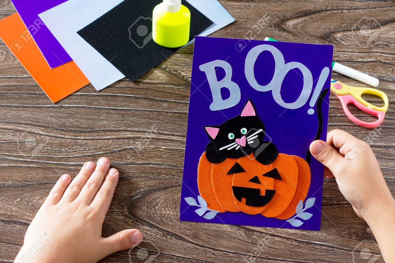 The child create a birthday card for halloween paper black cat the child create a birthday card for halloween paper black cat in pumpkin glue bookmarktalkfo Image collections