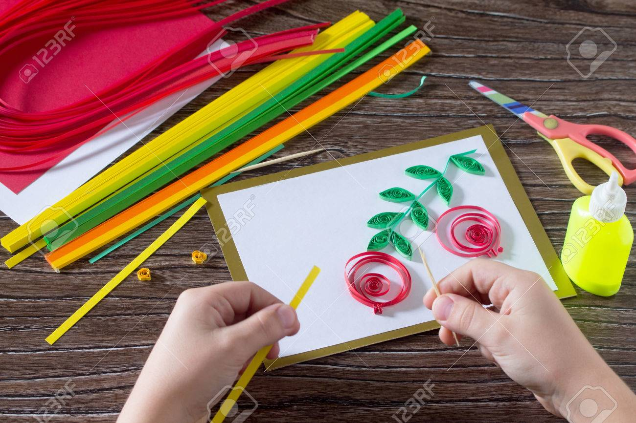 The child create greeting cards origami paper honey and garnet stock photo the child create greeting cards origami paper honey and garnet tree branch on a wooden table making of paper strips honey m4hsunfo