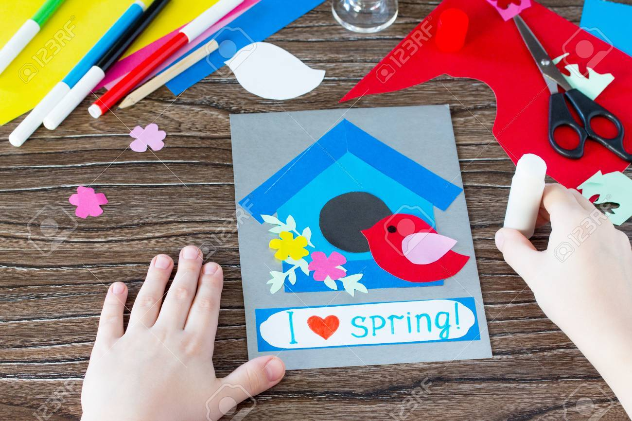 The child create a spring greeting card paper bird and birdhouse stock photo the child create a spring greeting card paper bird and birdhouse made by hand craft for kids childrens art project needlework m4hsunfo