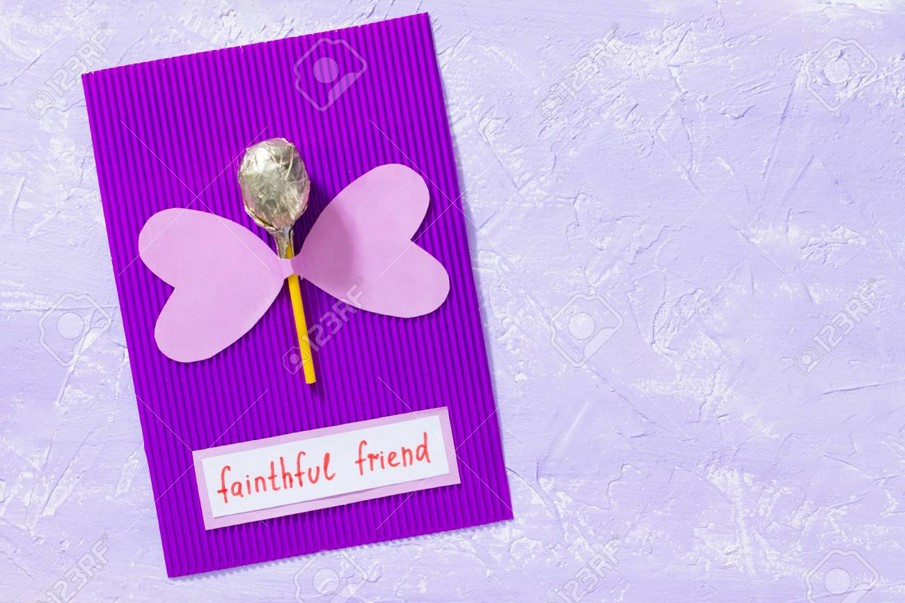 The Child Makes For A Greeting Card With Hearts And Butterfly