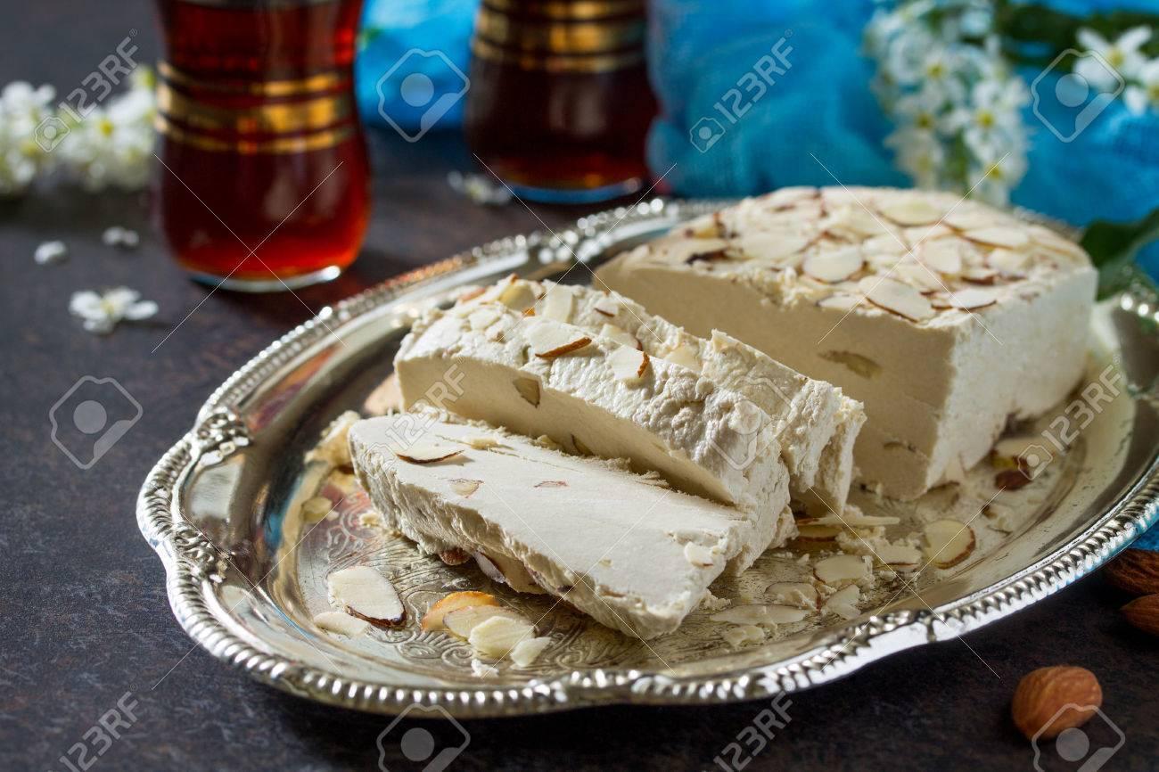 Halva Mit Mandelblüten Und Tee Auf Dem Küchentisch. Türkische Und ...