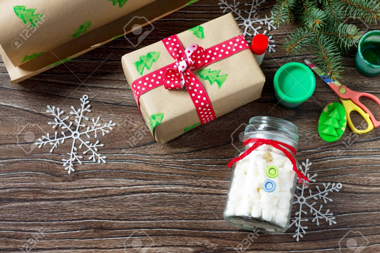christmas gift snowman sweets marshmallows in a jar made by own hands childrens art