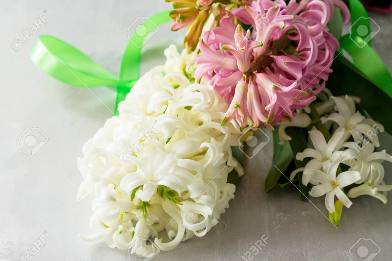 Bouquet of hyacinth flower on stone background or slate spring bouquet of hyacinth flower on stone background or slate spring flowers background stock photo izmirmasajfo